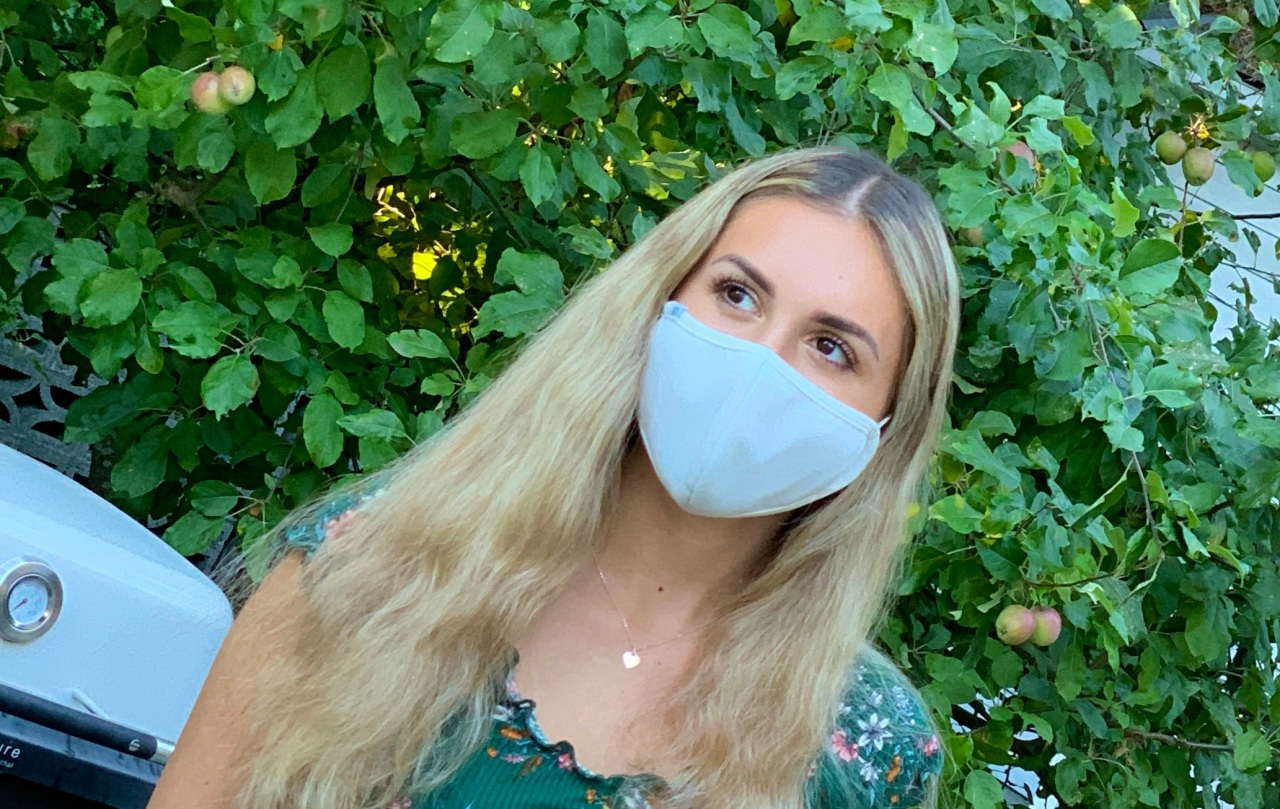 Woman wearing a facemask for blog explaining facemask fabric efficacy and safety.